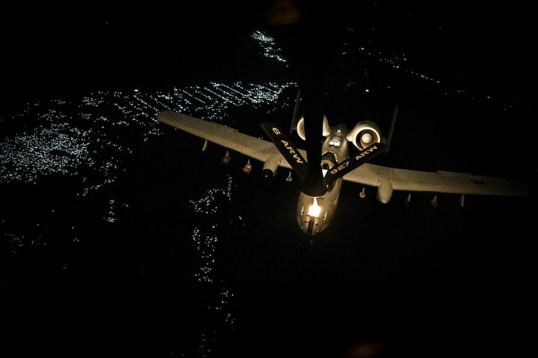 A U.S. Air Force A-10 Thunderbolt II is in-air refueled by a KC-135 Stratotanker with the 28th Expeditionary Air Refueling Squadron assigned to Al Udeid Air Base, Qatar, over Afghanistan, May 21, 2020.