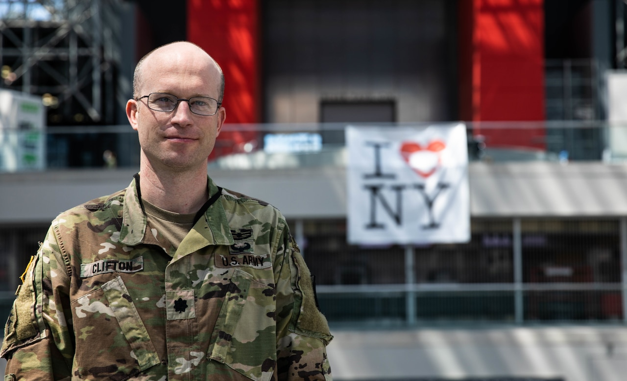 Army doctor in uniform poses for a photo.