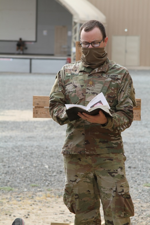 U.S. Army Maj. Timothy Miller, the Task Force Spartan Deputy Command Chaplain, assigned to the 42nd Infantry Division, gives a Christian Service in the Central Command Area of Operation, May 10, 2020. Miller gave the outdoor services in compliance with Department of Defense guidelines. (U.S. Army photo by Sgt. Andrew Valenza)
