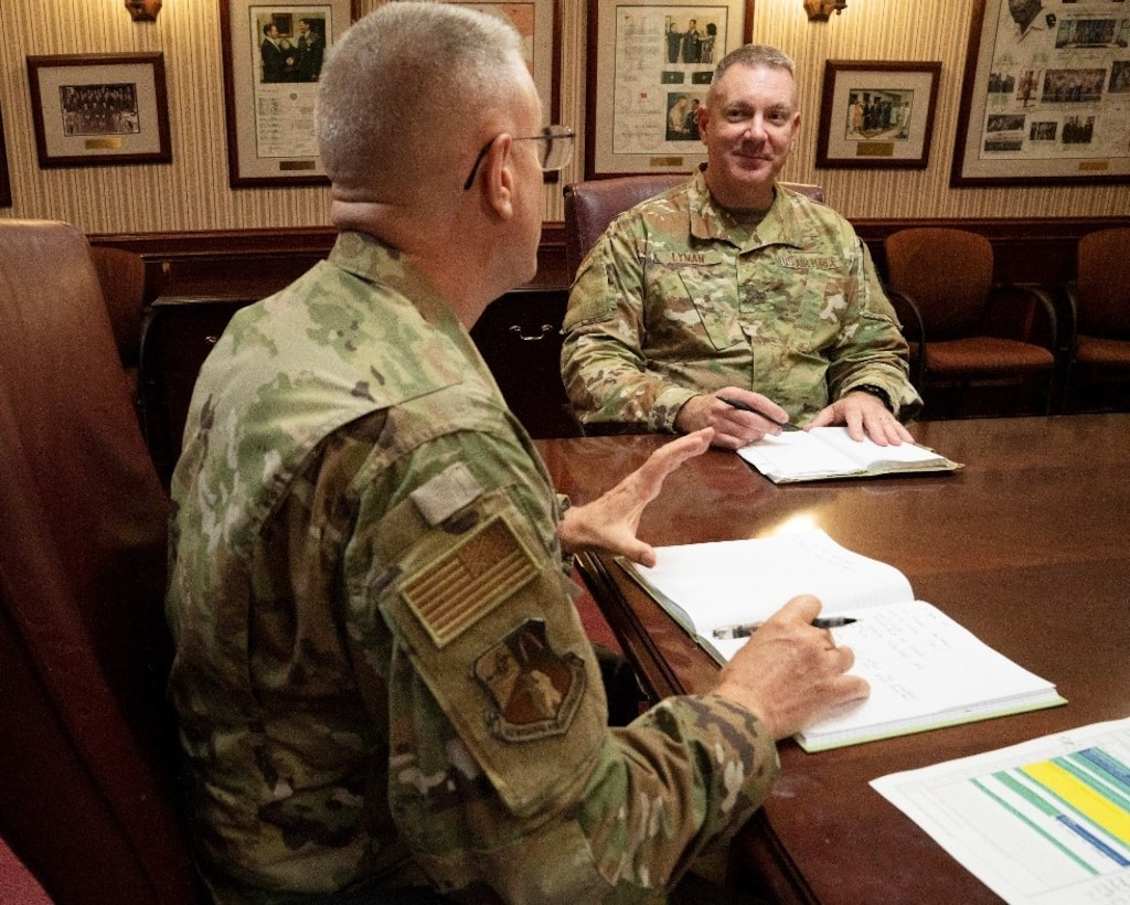 U.S. Air Force Brig. Gen. Robert Lyman, director, Command, Control, Communications, and Cyber Systems Directorate, TCJ6, pictured center, meets with U.S. Air Force Col. Mark Bradley, TCJ6 deputy director, on Tuesday, June 9.