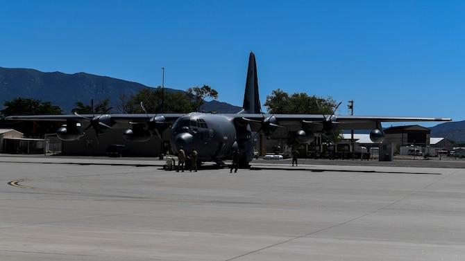 Airmen perform a pre-flight inspection.
