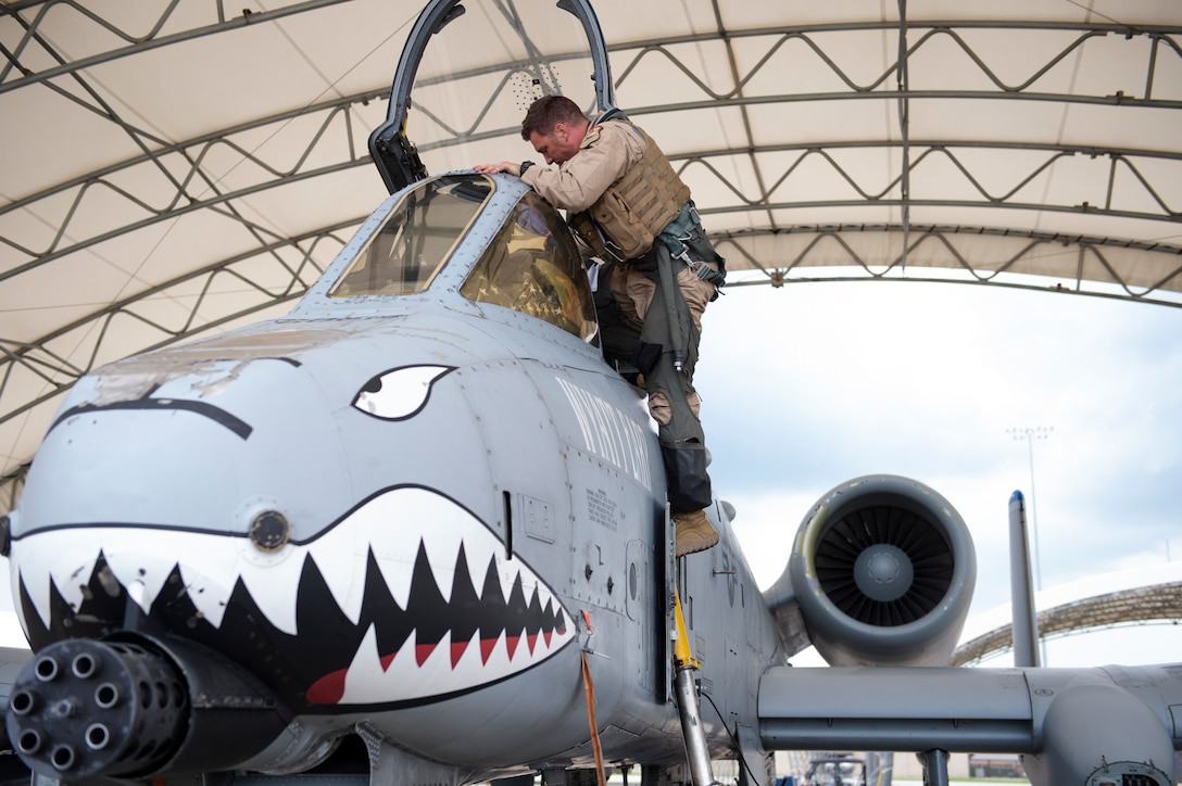 Lt. Col. Michael Sackenheim, 74th Expeditionary Fighter Squadron commander, climbs out of an A-10C Thunderbolt II after returning to home-station after a 5-month deployment June 10, 2020, at Moody Air Force Base, Georgia. Approximately 300 members assigned to the 74th EFS returned from deployment June 10-12. The 74th EFS, which consisted of personnel from the 23d Fighter Group and 23d Maintenance Group, were deployed as a part of Operation Freedom Sentinel. (U.S. Air Force photo by 2nd Lt. Kaylin P. Hankerson)