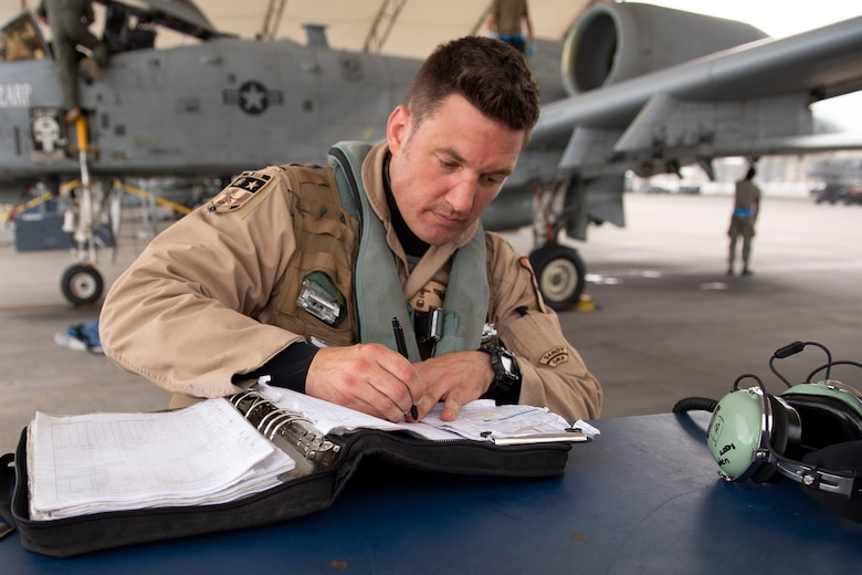 Lt. Col. Michael Sackenheim, 74th Expeditionary Fighter Squadron commander, completes a post-flight log after returning from a 5-month deployment June 10, 2020, at Moody Air Force Base, Georgia. Approximately 300 members assigned to the 74th EFS returned from deployment June 10-12. The 74th EFS, which consisted of personnel from the 23d Fighter Group and 23d Maintenance Group, were deployed as a part of Operation Freedom Sentinel. (U.S. Air Force photo by 2nd Lt. Kaylin P. Hankerson)