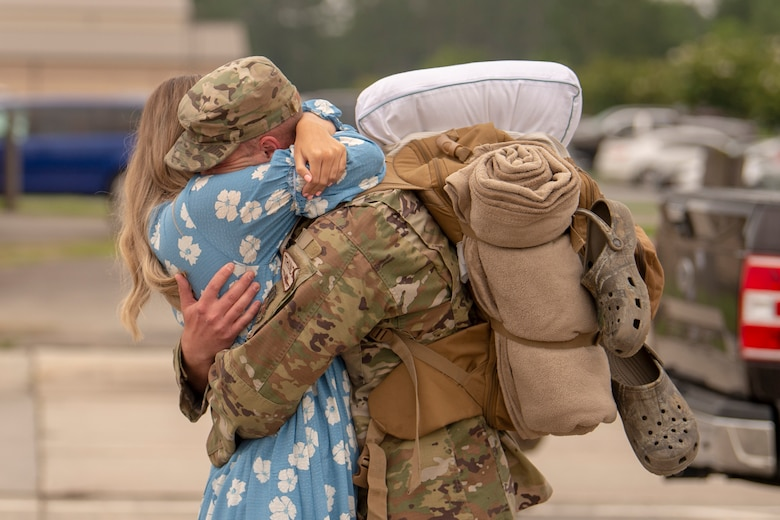 An Airman assigned to the 74th Expeditionary Fighter Squadron reunites with his significant other after a 5-month deployment June 10, 2020, at Moody Air Force Base, Georgia. Approximately 300 members assigned to the 74th EFS returned from deployment June 10-12. The 74th EFS, which consisted of personnel from the 23d Fighter Group and 23d Maintenance Group, were deployed as a part of Operation Freedom Sentinel. (U.S. Air Force photo by 2nd Lt. Kaylin P. Hankerson)
