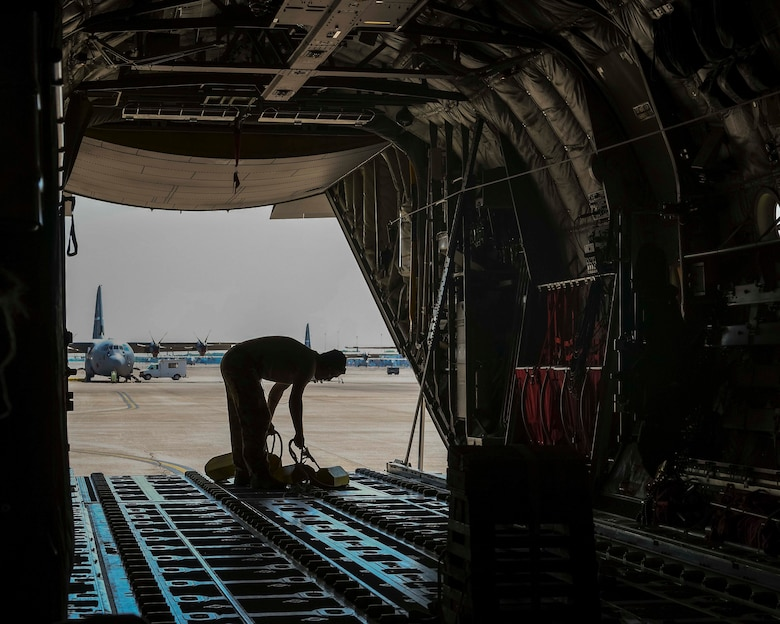 A U.S. Air Force loadmaster prepares a C-130J Super Hercules from Little Rock Air Force Base, Arkansas, for flight during a Joint Forcible Entry exercise near Las Vegas, June 6, 2020. More than 20 C-130Js and C-17 Globemaster IIIs flew in formation during the U.S. Air Force Weapons School's Joint Forcible Entry exercise with numerous other aircraft from across the Air Force. (U.S. Air Force photo by Senior Airman Kristine M. Gruwell)