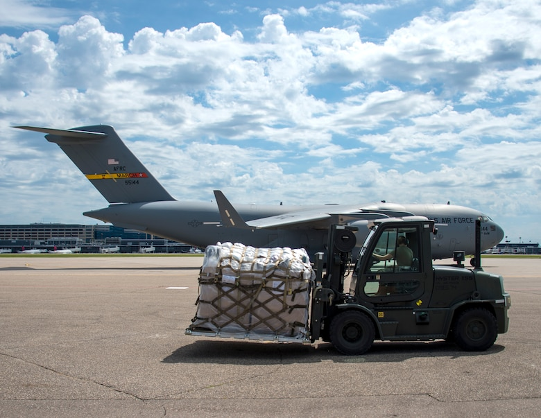 An airman awaits the ability to load a pallet of medical supplies palletized by members of the 133rd Airlift Wing's Air Transportation Function in St. Paul, Minn., June 13, 2020.