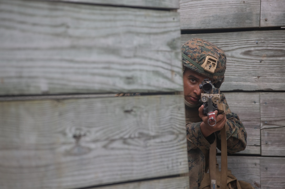 U.S. Marine Corps Lance Cpl. Alfrendy Grullon-Rodriguez, a rifleman with 2nd Light Armored Reconnaissance Battalion, 2nd Marine Division, sets security during the Isaak Competition at Camp Geiger, iNorth Carolina, June 9, 2020. 2nd LAR hosts the annual competition to honor Cpl. Garreth Isaak a LAR Marine who earned the Silver Star posthumously for actions during Operation Just Cause. (U.S. Marine Corps photo by Lance Cpl. Reine Whitaker)