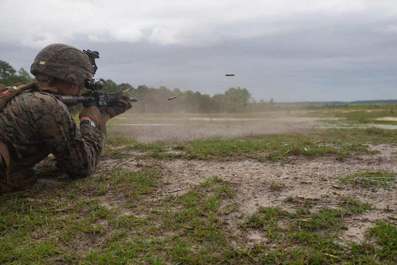 U.S. Marine Corps Lance Cpl. John Taylor, a rifleman with 2nd Light Armored Reconnaissance Battalion, 2nd Marine Division, fires at a target of an unknown distance, during the Isaak Competition at Camp Geiger, North Carolina, June 10, 2020. 2nd LAR hosts the annual competition to honor Cpl. Garreth Isaak, a LAR Marine who earned the Silver Star posthumously for actions during Operation Just Cause. (U.S. Marine Corps photo by Lance Cpl. Reine Whitaker)