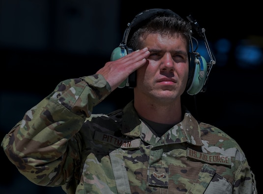An Airmen salutes.