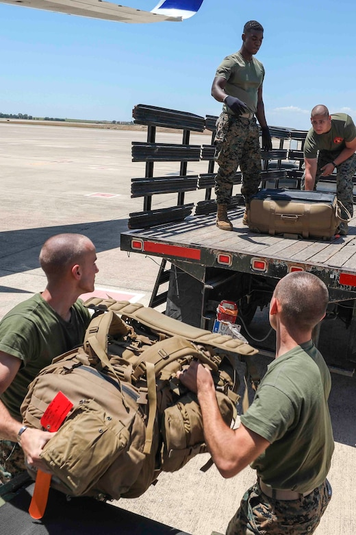 U.S. Marines with Special Purpose Marine Air-Ground Task Force-Crisis Response-Africa 20.2, Marine Forces Europe and Africa, load gear onto a vehicle after arriving at Móron Air Base, Spain June 9, 2020. SPMAGTF-CR-AF 20.2 is deployed to conduct crisis-response and theater-security operations in Africa and promote regional stability by conducting military-to-military training exercises throughout Europe and Africa. SPMAGTF-CR-AF 20.2 continues to work closely with the relevant medical agencies and military organizations to minimize risk of COVID-19 exposure. (U.S. Marine Corps photo by Cpl. Tawanya Norwood)