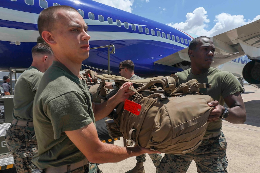 U.S. Marines with Special Purpose Marine Air-Ground Task Force-Crisis Response-Africa 20.2, Marine Forces Europe and Africa, offload gear from a plane after arriving at Móron Air Base, Spain, June 9, 2020. SPMAGTF-CR-AF 20.2 deployed to conduct crisis-response and theater-security operations in Africa and promote regional stability by conducting military-to-military training exercises throughout Europe and Africa. SPMAGTF-CR-AF 20.2 continues to work closely with the relevant medical agencies and military organizations to minimize risk of COVID-19 exposure. (U.S. Marine Corps photo by Cpl. Tawanya Norwood)