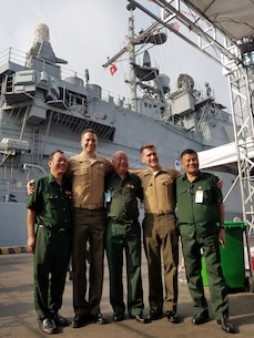 Maj Casey and Capt Grant, Southeast Asia FAOs support U.S. and Vietnamese veterans exchange event during the USS Theodore Roosevelt Carrier Strike Group visit to Danang, Vietnam.