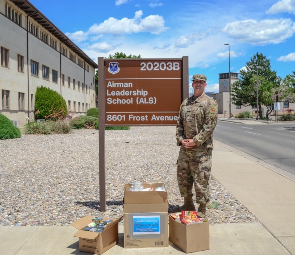 Airman stands with donated goods