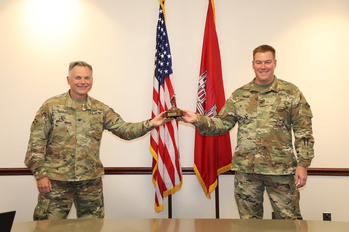 At left, Col. Philip Secrist, the Commander of the U.S. Army Corps of Engineers Transatlantic Middle East District presents the Commander of USACE's Transatlantic Division Col.  (P) Christopher Beck with an alidade as a token of thanks for his leadership. The alidade has been used for hundreds of years by engineers, and the word is of Middle Eastern origin, making it especially appropriate for our District. Col. Beck took command of the Transatlantic Division in June 2019 and will relinquish command of the Division on 16 June. His next assignment will be the commander of USACE's Southwestern Division.