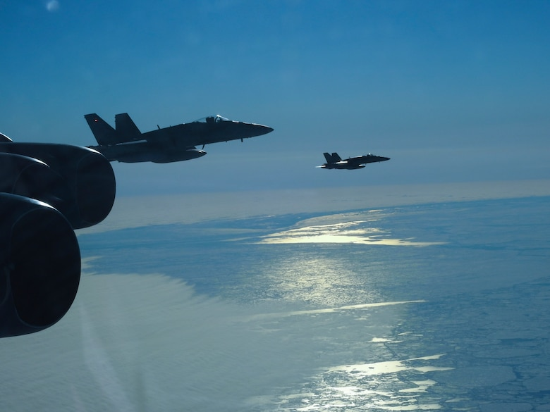 A Royal Canadian Air Force CF-18 Hornet, assigned to the Royal Canadian Air Force, escorts a B-52 Stratofortress during a North American Aerospace Defense Command (NORAD) mission, June 14, 2020. NORAD routinely conducts intercept training in support of its mission to protect the sovereign airspaces of the United States and Canada. (Courtesy Photo)