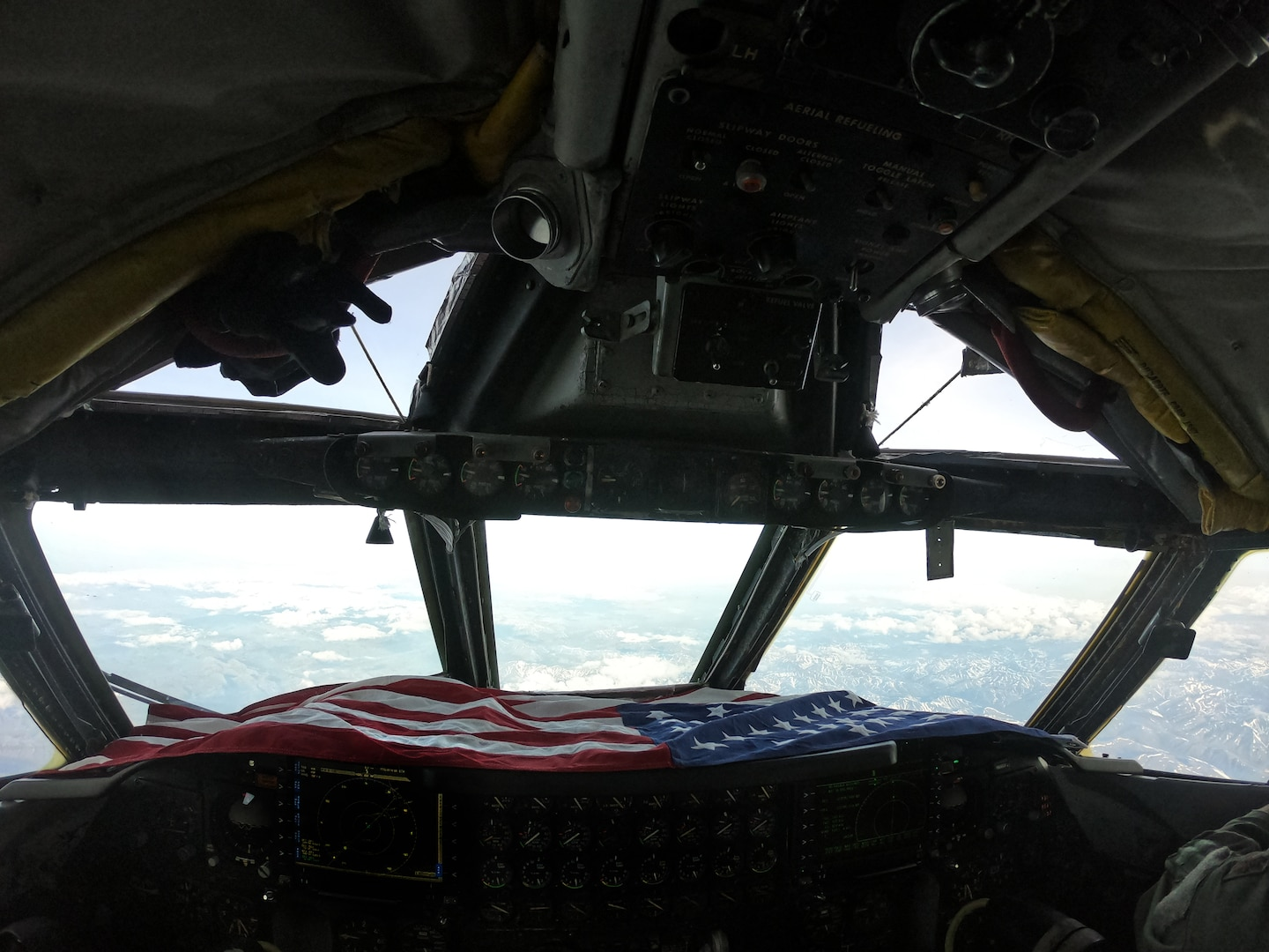 An American flag sits in the cockpit of a B-52 Stratofortress during a North American Aerospace Defense Command (NORAD) mission, June 14, 2020. NORAD routinely conducts intercept training in support of its mission to protect the sovereign airspaces of the United States and Canada. (Courtesy Photo)
