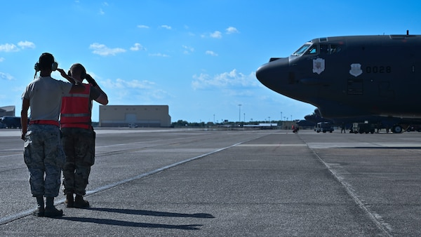 Senior Airman Tyler Burke (left) and Airman 1st Class Ethan Wright (right), both 96th Aircraft Maintenance Unit crew chiefs, salute as a B-52H Stratofortress begins to taxi at Barksdale Air Force Base, La., June 13, 2020. The B-52 was departing for Eielson Air Force Base, Alaska, to integrate and operate in the Indo-Pacific theater. (U.S. Air Force photo by Staff Sgt. Stuart Bright)
