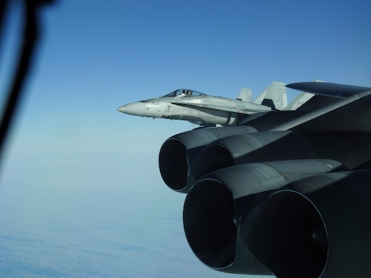 A Royal Canadian Air Force CF-18 Hornet, escorts a B-52 Stratofortress during a North American Aerospace Defense Command (NORAD) mission, June 14, 2020. NORAD routinely conducts intercept training in support of its mission to protect the sovereign airspaces of the United States and Canada. (Courtesy Photo)