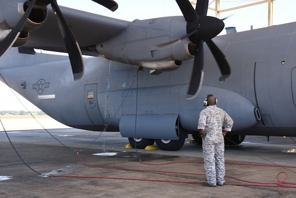 "Master Sgt. Donald Maloid, 403rd Maintenance Squadron propulsion technician, checks the water spray and mist that comes out of the engine compartment during the Engine Compressor Wash of an 815th Airlift Squadron C-130J Super Hercules to ensure the engine is clean before the aircraft goes for a ""C"" letter inspection in the Isochronal Dock at Keesler Air Force Base, Mississippi May 11, 2020. These inspections or letter checks can range from ""A"" five days basic check, ""B"" 18 days and more in depth, to ""C"" 22 days which is the most intrusive inspection; but are necessary to keep the aircraft maintained. (U.S. Air Force photo by Jessica L. Kendziorek)"