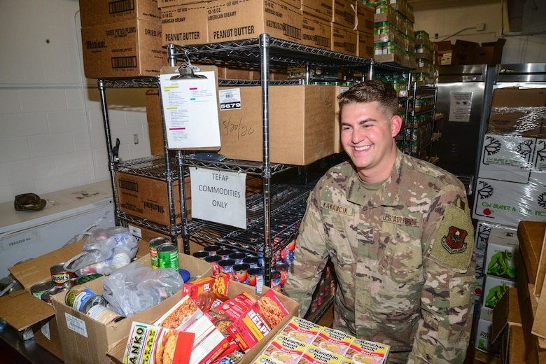 Airman unpacks boxes of donations