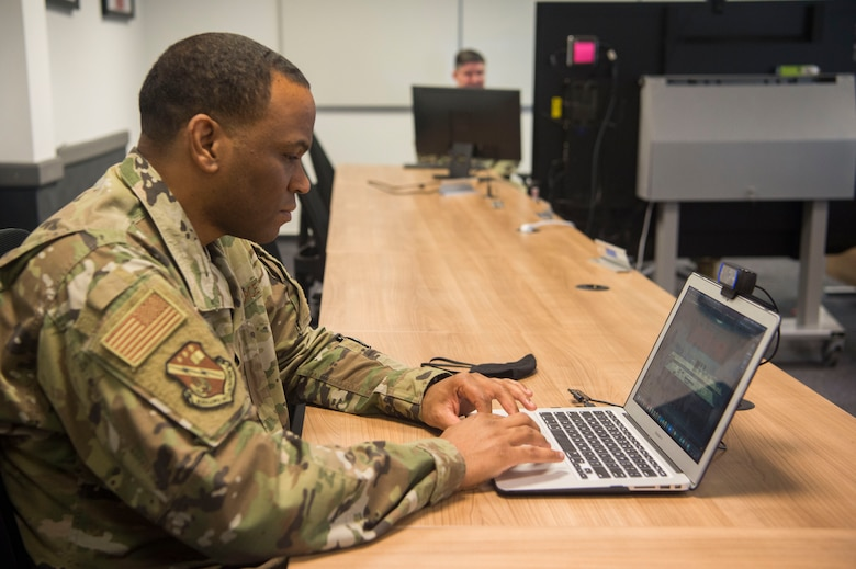 Chief Master Sgt. Terrance Smiley, Kisling Noncommissioned Officer Academy commandant, tests the virtual platforms for the upcoming online professional military education course at Kapaun Air Station, Germany, June, 12, 2020. The Academy cadre devoted three months in professional development training so they could tailor the curriculum to an online format. (U.S. Air Force photo by TSgt Stephen Ocenosak)