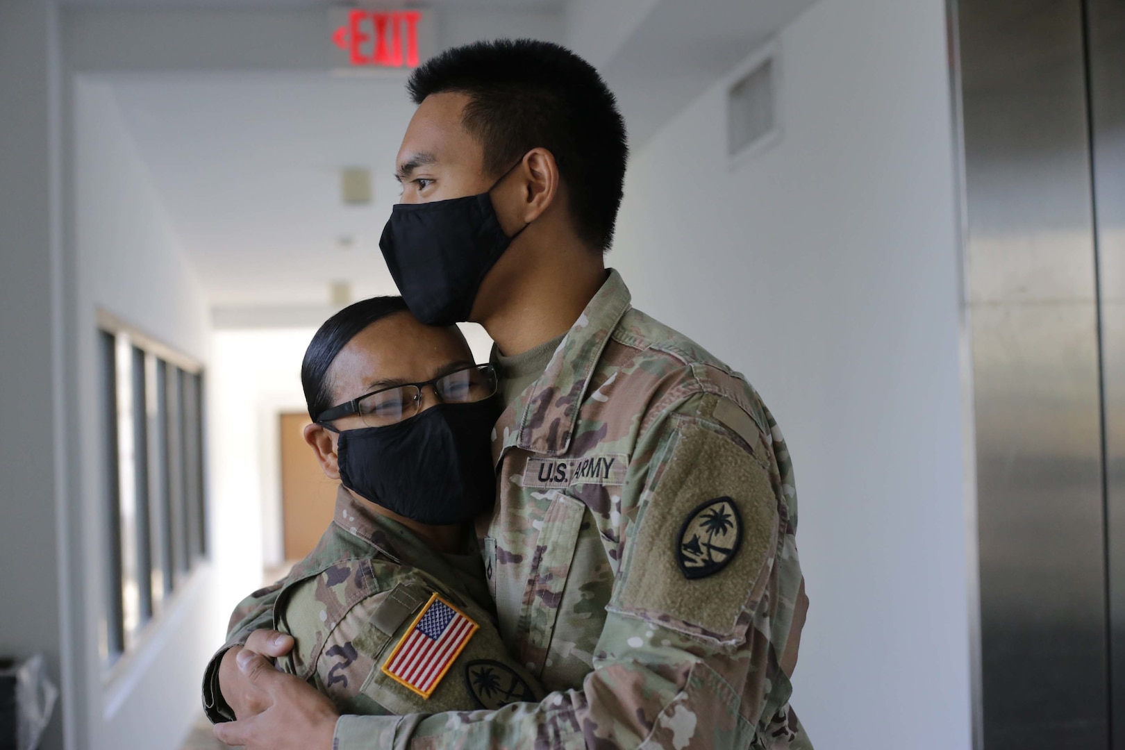 Lt. Col. Marlene Tarusan-Legaspi and her son, Pfc. Nikolas Legaspi, both with the Guam Army National Guard, find time during their COVID-19 missions to spend a moment together in Tamuning, Guam, June 8, 2020. Tarusan-Legaspi and her son were activated to support the government of Guam's response to the COVID-19 pandemic.