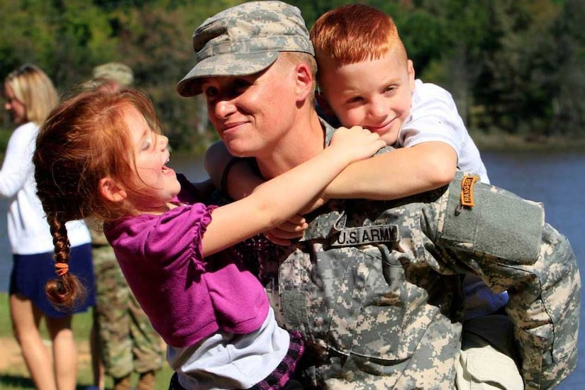 Female Army officer and family