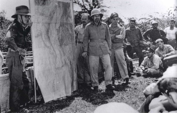 British general Orde Wingate (in pith helmet), commander of the Chindits, briefs the C-47 Dakota pilots of the 1st Air Commando, US Army Air Forces, in Burma.