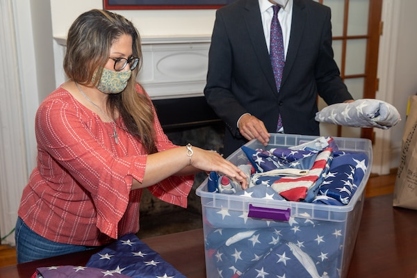 Norfolk Naval Shipyard's Veteran Employee Readiness Group (VET-ERG) Member Teresa Coon boxes 113 U.S. Flags to provide to Sturtevant Funeral Home June 12 in honor of Flag Day. The flags were donated from the workforce and from within the community to be part of Sturtevant's Retire the Flag Program.