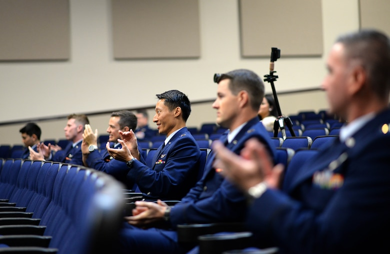 Specialized Undergraduate Pilot Training Class 20-16/17 sit in the Kaye Auditorium during their graduation ceremony June 12, 2020, on Columbus Air Force Base, Miss. The students endured a 53-week training program in order to earn the title of an Air Force pilot. (U.S. Air Force photo by Senior Airman Keith Holcomb)