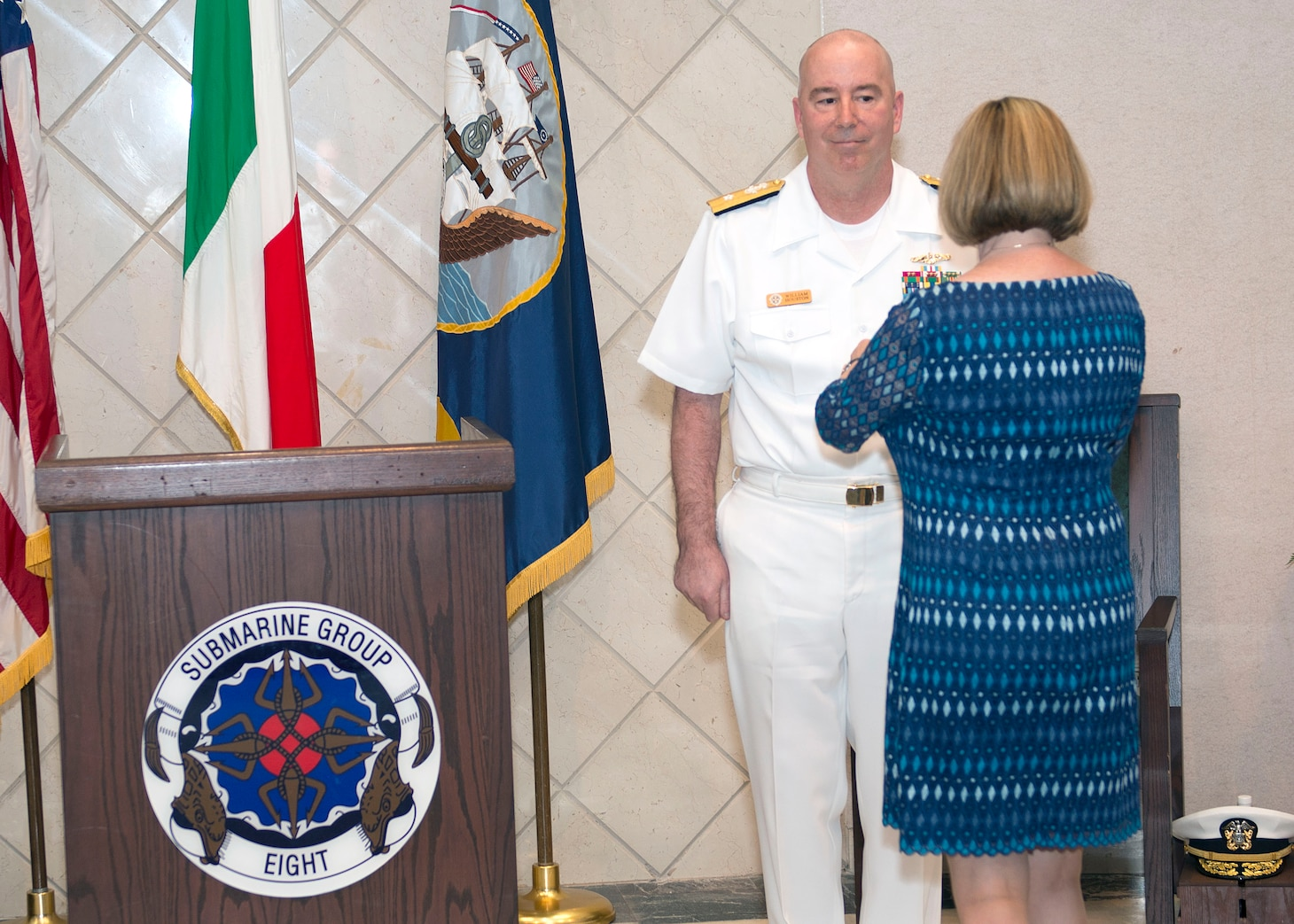 200616-N-DF478-0050 NAPLES, Italy (June 16, 2020) – Rear Adm. William J. Houston is pinned the Legion of Merit for his meritorious conduct in the performance of outstanding services and achievements while serving as Commander, Submarine Group (CSG) 8 by his wife Colleen during a change of command ceremony in Naples, Italy, June 16, 2020. Rear Adm. Anthony C. Carullo relieved Rear Adm. William J. Houston as commander of the submarine group. U.S. 6th Fleet, headquartered in Naples, Italy, conducts the full spectrum of joint and naval operations, often in concert with allied and interagency partners in order to advance U.S. national interests and security and stability in Europe and Africa. (U.S. Navy photo by Mass Communication Specialist 1st Class Marvin E. Thompson Jr.)