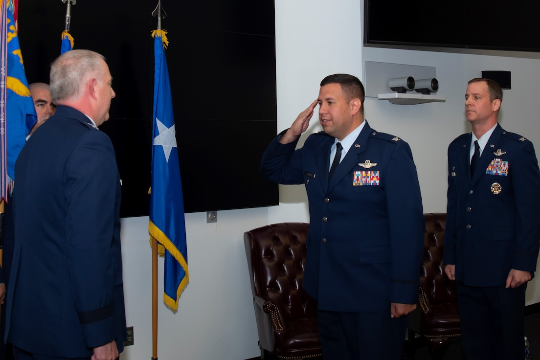"Col. Joseph ""Jacko"" M. Vanoni (center) assumes command of the 43d Air Mobility Operations Group from Col. Timothy S. Danielson (right). Maj. Gen. John R. Gordy (left), commander of the U.S. Air Force Expeditionary Center at Joint Base McGuire-Dix-Lakehurst, N.J., presided over the change of command ceremony."