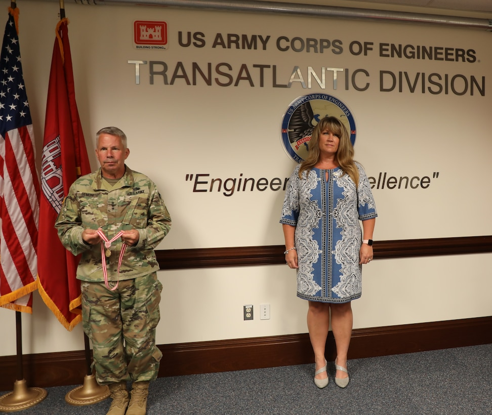 Lt. Gen. Todd T. Semonite, the 54th Chief of Engineers and Commanding General of the U.S. Army Corps of Engineers (left), presents Sally Beck with the Meritorious Public Service Medal. The award was given to Sally for all the work she did supporting families across the Army – specifically the men and women assigned to the Transatlantic Division during the command of her spouse, Col. (P) Chris Beck. Due to COVID-19 restrictions, the award was presented while practicing social distancing.