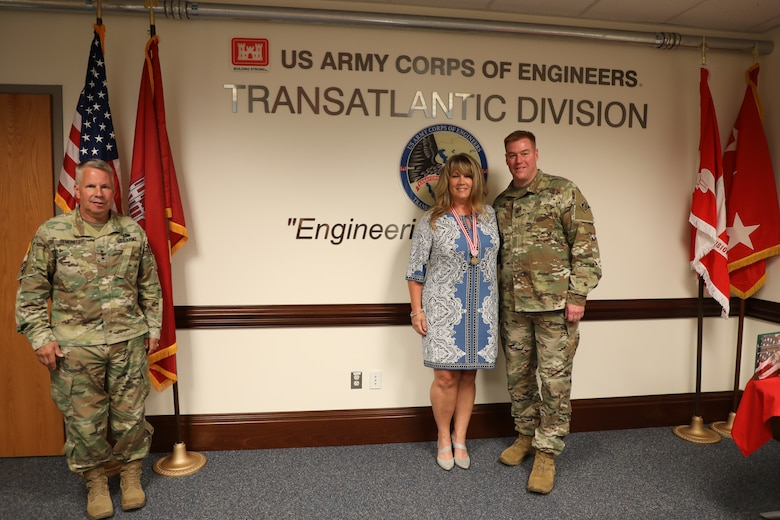Lt. Gen. Todd T. Semonite, the 54th Chief of Engineers and Commanding General of the U.S. Army Corps of Engineers (left), presents Sally Beck with the Meritorious Public Service Medal. The award was given to Sally for all the work she did supporting families across the Army – specifically the men and women assigned to the Transatlantic Division during the command of her spouse, Col. (P) Chris Beck (right). Due to COVID-19 restrictions, the award was presented while practicing social distancing.