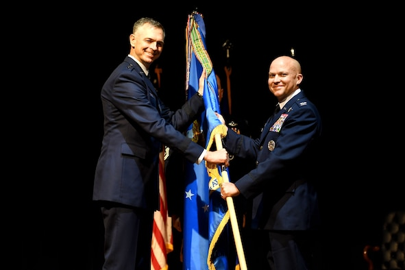 Col. Joseph Miller, incoming 314th Airlift Wing commander, right, assumes command of the 314th AW during a change of command ceremony June 16, 2020, at Little Rock Air Force Base, Arkansas. Miller, who began his Air Force career in 1998 after graduating the University of Alabama, is an evaluator/instructor in three variants of the C-130 and has accumulated over 2,800 flight hours including 590 combat hours in support of contingency operations. (U.S. Air Force photo Senior Airman Kristine M. Gruwell)