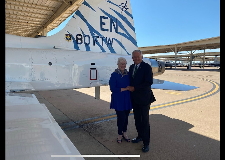 Glenn Barham, President of the Sheppard Military Affairs Committee, and his wife Mary Lynne pose for a photo at Sheppard Air Force Base, Texas, June 5, 2020. They were the most recent inductees to the Euro-NATO Joint Jet Program's Hall of Fame. Their support towards the 80th Flying Training Wing includes, organizing support for air shows, steering committee dinners, securing state funding and much more. (U.S. Air Force photo by 2nd Lt. Megan Morrissey)