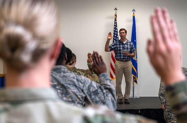 U.S. Secretary of Defense Dr. Mark T. Esper administers the oath of enlistment during his visit June 16, 2020, at Joint Base San Antonio-Lackland, Texas. Esper met with AETC leaders to see firsthand how Basic Military Training is fighting through COVID-19 with health protection measures in place and adapting operations to current Centers for Disease Control and Prevention Guidance. The visit also allowed him to witness how a citizen becomes an Airman during COVID-19.