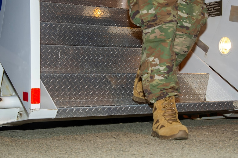 An Airman assigned to the 940th Maintenance Group deplanes and steps foot on to the ground after returning from deployment June 14, 2020, at Beale Air Force Base, California.
