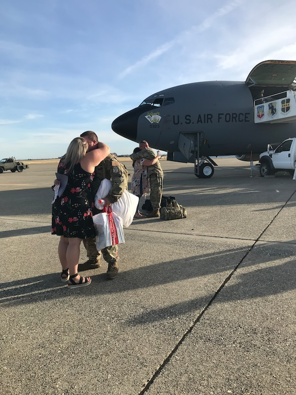 Two couples embrace in hugs June 14, 2020, at Beale Air Force Base, California.