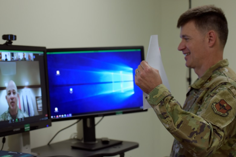 U.S. Air Force Col. Thomas Coakley, 17th Training Group commander, shows the virtually present Col. Andres Nazario, 17th Training Wing commander, the Memorandum of Understanding before signing it into effect in the Brandenburg Hall on Goodfellow Air Force Base, Texas, June 11, 2020. This MOU officially solidified several years of previous partnerships and cooperation between the 17 Training Group and Angelo State University, Howard College, San Angelo Independent School District. (U.S. Air Force photo by Senior Airman Zachary Chapman)