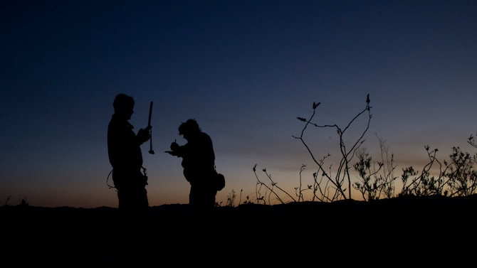 A photo of Airmen using communication tools