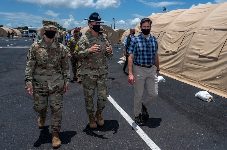 Tech. Sgt. Kyle Shy, 320th Training Squadron military training instructor, briefs U.S. Secretary of Defense Dr. Mark T. Esper during a tour of the U.S. Air Force basic military training's Basic Expeditionary Airfield Resources base June 16, 2020, at Joint Base San Antonio-Lackland, Texas. Esper met with AETC leaders to see firsthand how BMT is fighting through COVID-19 with health protection measures in place and adapting operations to current Centers for Disease Control and Prevention Guidance. The visit also allowed him to witness how a citizen becomes an Airman during COVID-19.