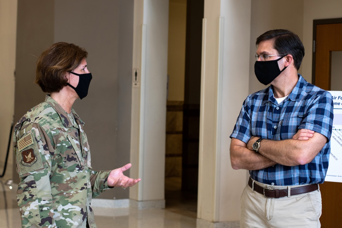 U.S. Air Force Maj. Gen. Andrea Tullos (left), 2nd Air Force commander, briefs Defense Secretary Dr. Mark T. Esper (right), during a tour of the Pfingston Reception Center June 16, 2020, at Joint Base San Antonio-Lackland, Texas. Esper met with AETC leaders to see firsthand how Basic Military Training is fighting through COVID-19 with health protection measures in place and adapting operations to current Centers for Disease Control and Prevention Guidance. The visit also allowed him to witness how a citizen becomes an Airman during COVID-19. (U.S. Air Force photo by Sarayuth Pinthong)