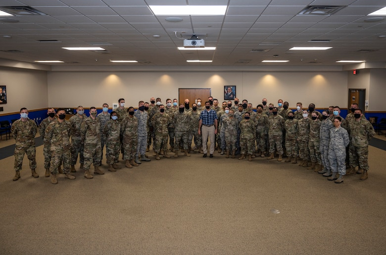 U.S. Secretary of Defense Dr. Mark T. Esper poses for a group photo with JBSA airmen after administering the oath of enlistment during his visit June 16, 2020, at Joint Base San Antonio-Lackland, Texas. Esper met with AETC leaders to see firsthand how Basic Military Training is fighting through COVID-19 with health protection measures in place and adapting operations to current Centers for Disease Control and Prevention Guidance. The visit also allowed him to witness how a citizen becomes an Airman during COVID-19.