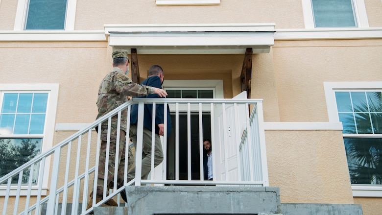 Hon. John Henderson, the Assistant Secretary of the Air Force for Environment, Installations and Energy, and U.S. Air Force Col. Edward Phillips, the 6th Mission Support Group commander, enter a house on MacDill Air Force Base, Fla., June 10, 2020.