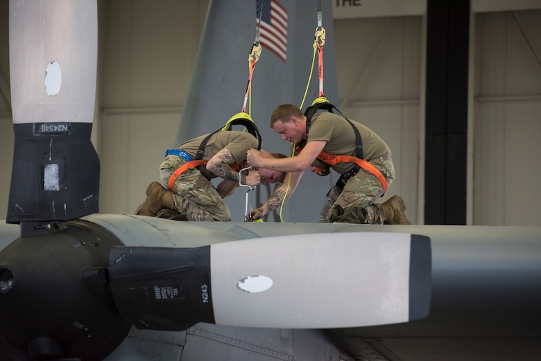 A photo of Airmen working on an aircraft.