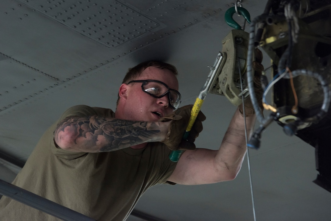 A photo of an Airman working on an aircraft.