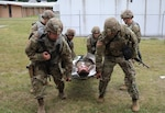 New York Army National Guard Soldiers assigned to the 466th Medical Company, Area Support, lift a simulated patient during a mass casualty exercise at pre-mobilization training at Camp Smith Training Site in Cortlandt Manor, N.Y. The company is deploying to the area of Central Command this summer.