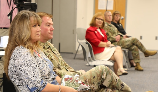 U.S. Army Corps of Engineers Transatlantic Division Commander Col. Christopher Beck and his wife Sally listen as USACE Commanding General Lt. Gen. Todd T. Semonite delivers remarks during Beck's relinquishment of command ceremony held June 16, 2020, in Winchester, Virginia. Semonite hosted the event, which was modified to incorporate social distancing due to COVID-19, meaning couples could sit together but everyone else had to maintain at least six feet of distance. Picture in the background are Connie Semonite, and USACE Command Sergeant Major Bradley Houston and his wife, Kim.