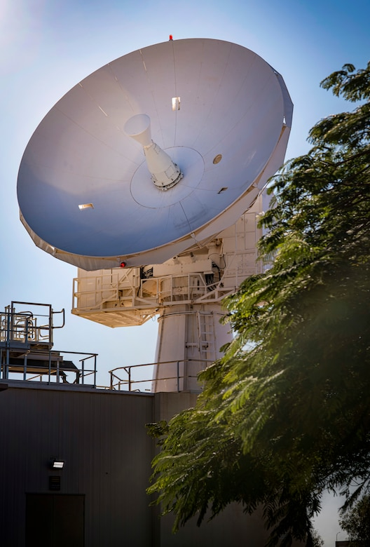 A large radar system is tilted toward the sky.